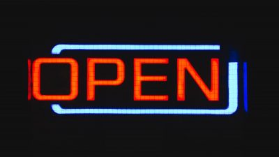 "Neon sign reading ""Open"" in red capital letters"