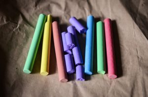 Various colors of chalk with some pieces broken