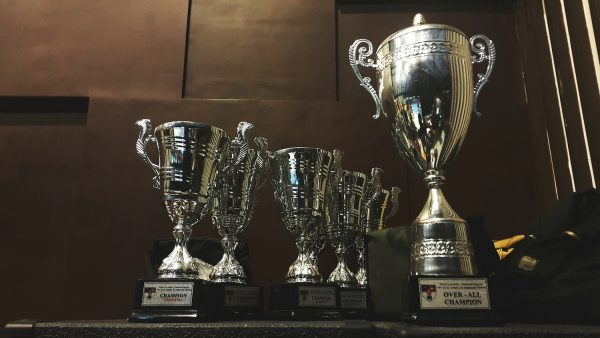 A row of silver champion trophy cups